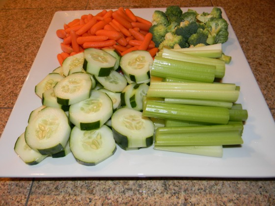Fresh cut carrots, broccoli, cucumber and celery. So easy, fresher and much cheaper, to put your own tray together than buying pre-made from the grocery.